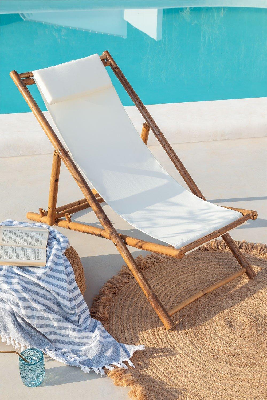 Hoy en día podemos trasladar las charlas al fresco a nuestra terraza o jardín. Sólo hace falta un asiento cómodo y una conversación para disfrutar de sus beneficios. En la imagen, hamaca con cojín en bambú de Sklum (69,95 euros).
