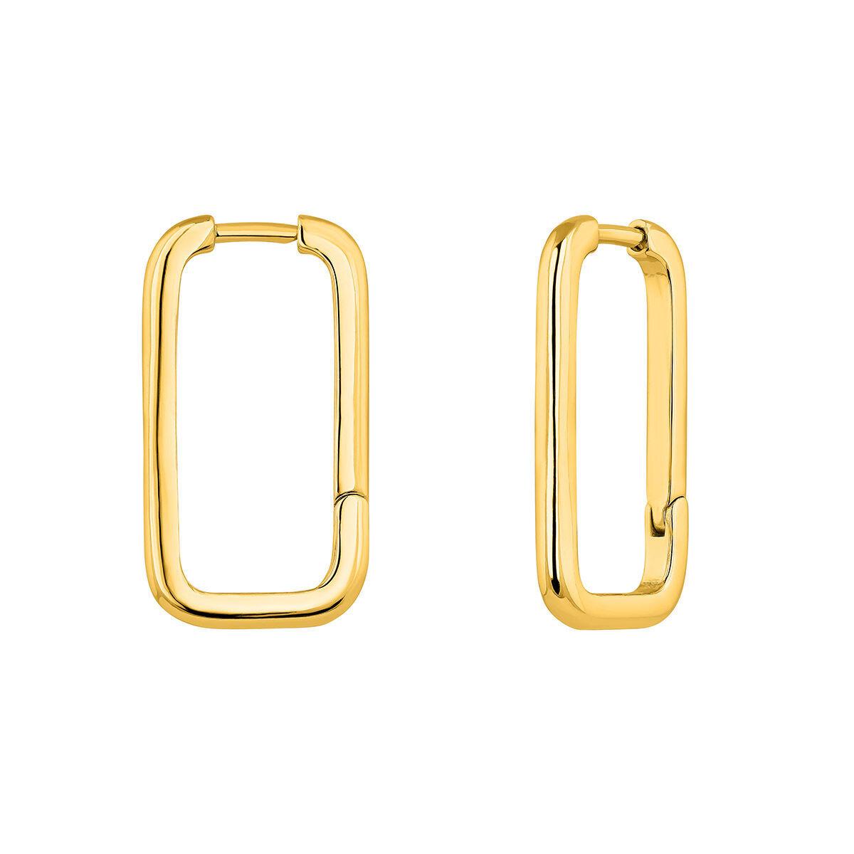 Nos gustan estos aros de plata bañada en oro de Aristocrazy (69 euros). Un toque estructural perfecto con este look impecable.