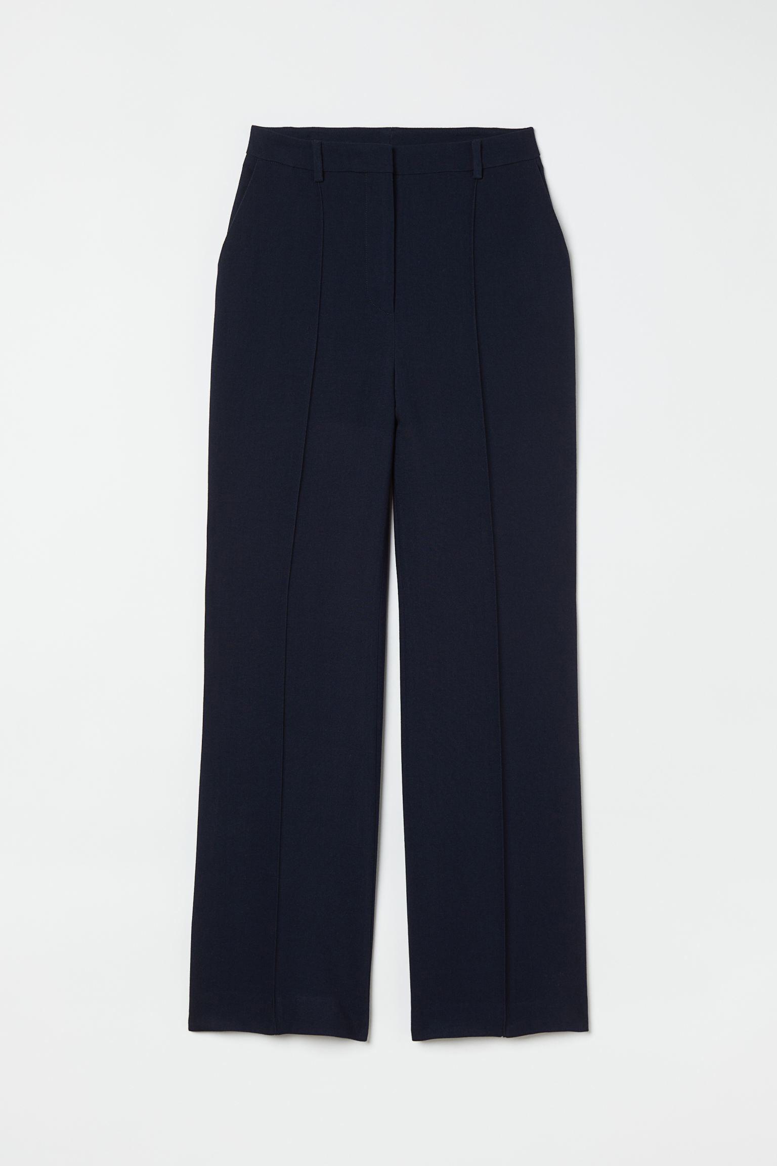 Pantalón de traje con lana azul noche, H&M (89,99 euros).
