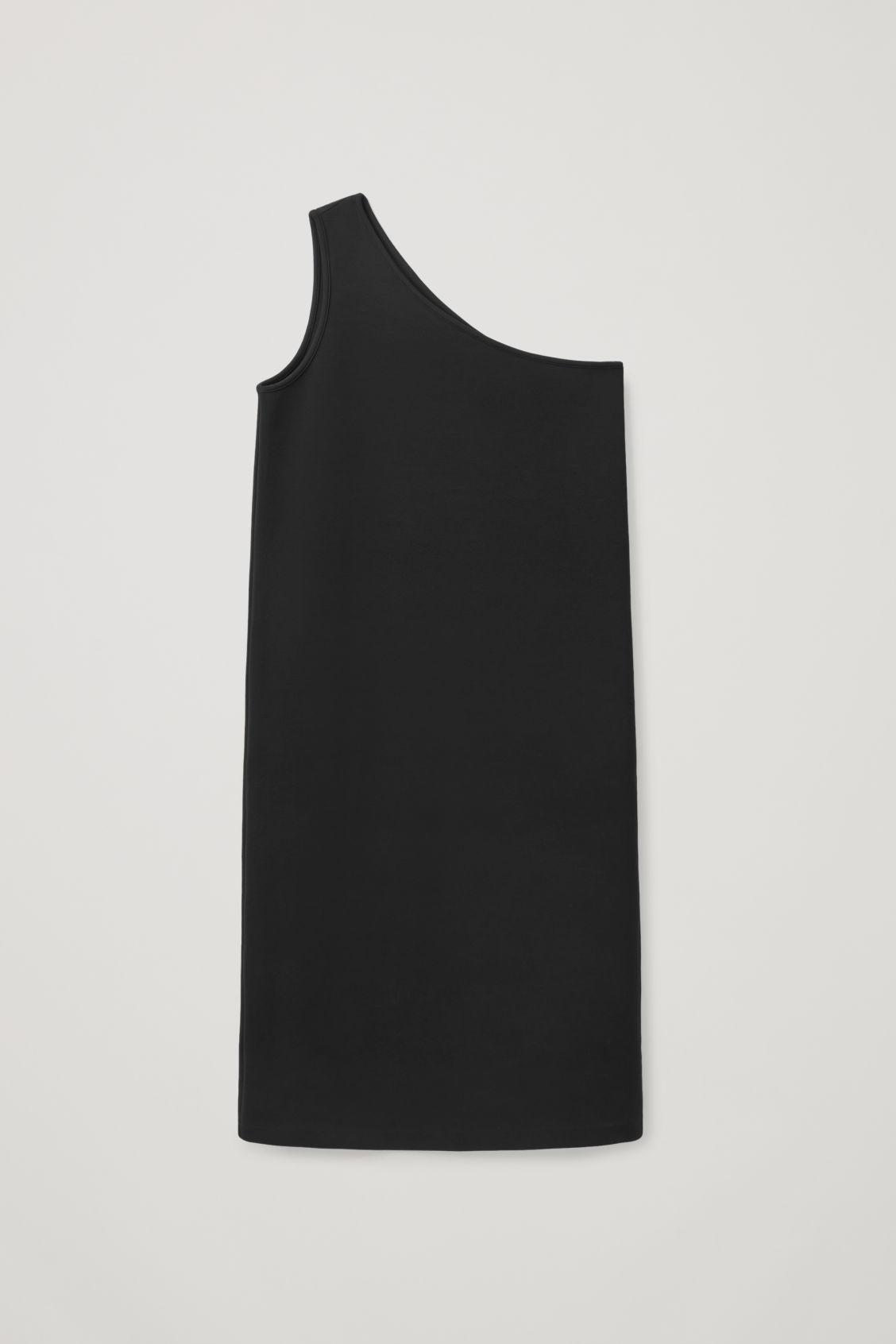 Vestido con hombro descubierto en algodón. Cos (69 euros).