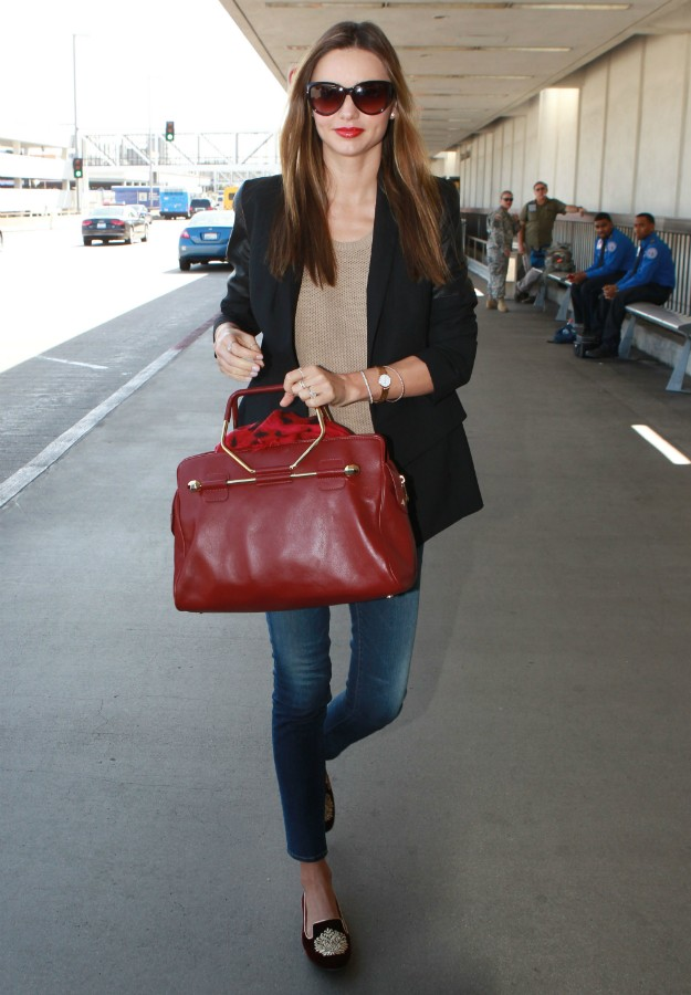 Miranda Kerr with black blazer, jeans, Viktor & Rolf Bombette bag and burgundy slippers