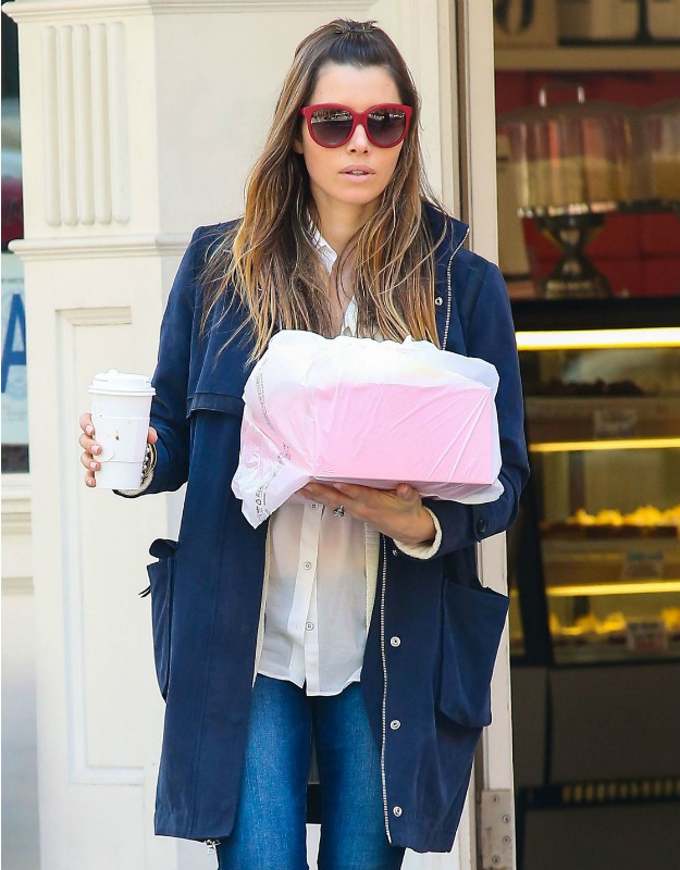 Jessica Biel with blue parka jacket, capri jeans, cream blouse and striped slippers