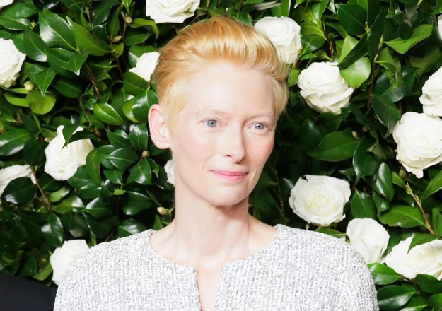 Tilda Swinton wearing a beige & cream jacket and white pants from the 2014 Spring/Summer RTW collect