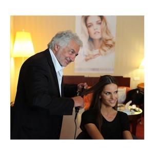 Franck Provost junto a la top Izabel Goulart.